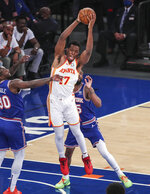 Atlanta Hawks forward Onyeka Okongwu (17) grabs a rebound during the first quarter against the New York Knicks in Game 5 of an NBA basketball first-round playoff series Wednesday, June 2, 2021, in New York. (Wendell Cruz/Pool Photo via AP)