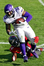 Tampa Bay Buccaneers inside linebacker Lavonte David (54) trips up Minnesota Vikings fullback C.J. Ham (30) after a short gain during the second half of an NFL football game Sunday, Dec. 13, 2020, in Tampa, Fla. (AP Photo/Mark LoMoglio)