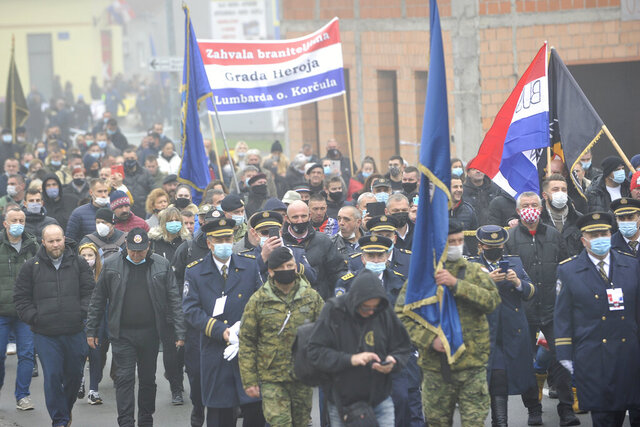 Military officers and civilians take part in a commemoration march in Vukovar, Croatia, Wednesday, Nov. 18, 2020. Some thousands marched to commemorate the suffering of Croatia's eastern city of Vukovar during the 1991-95 war despite a continuously high number of infection and fatalities from the new coronavirus. (AP Photo)