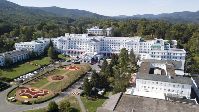 FILE - This Sept. 15, 2019, file photo shows The Greenbrier resort nestled in the mountains in White Sulphur Springs, W.Va. At least six of billionaire West Virginia Gov. Jim Justice family entities received the Paycheck Protection Program loans, including the governor's lavish resort The Greenbrier, as well as The Greenbrier Sporting Club, an exclusive members-only club linked to the resort. (AP Photo/Steve Helber, File)