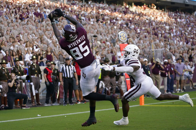 Texas A&M tight end Jalen Wydermyer (85) catches a pass for a touchdown over Mississippi State safety Fred Peters (38) during the first half of an NCAA college football game, Saturday, Oct. 2, 2021, in College Station, Texas. (AP Photo/Sam Craft)