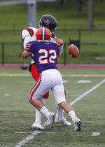 In this image provided by Hobart and William Smith Colleges, Hobart linebacker Emmett Forde knocks the ball loose as he sacks RPI quarterback George Marinopoulos during a college football game, Oct. 12, 2019 in Geneva, N.Y. There will be no pregame Victory Walk or singing of the alma mater after wins at Hobart College's 3,000-seat Boswell Field this fall. The coronavirus pandemic has led to the cancellation or postponement of more than 1,800 games across the NCAA, more than 1,000 in Division III. (Kevin Colton/Hobart and William Smith Colleges via AP)