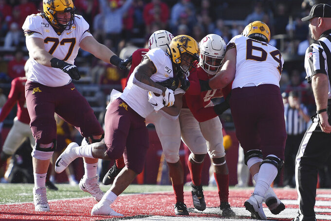 Minnesota running back Rodney Smith (1) runs into the end zone for a touchdown during the first half of an NCAA college football game against Rutgers Saturday, Oct. 19, 2019, in Piscataway, N.J. (AP Photo/Sarah Stier)