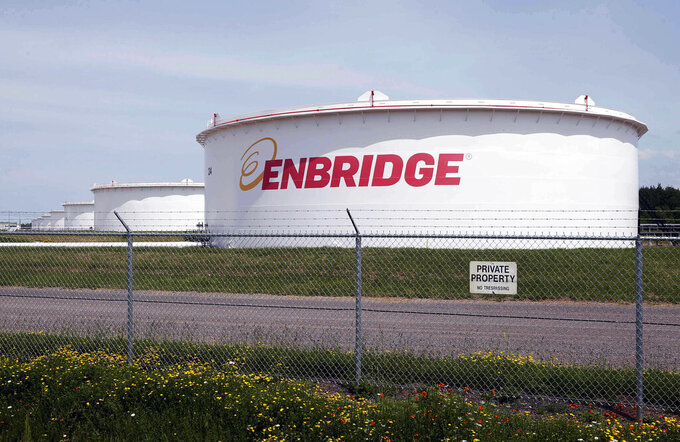 """FILE - This June 29, 2018 file photo shows tanks at the Enbridge Energy terminal in Superior, Wis. The state of Minnesota has gone to federal court to block a lawsuit over Enbridge Energy's Line 3 oil pipeline project from proceeding in tribal court. The novel case names Manoomin — the Ojibwe word for wild rice — as the lead plaintiff. Wild rice is sacred in Ojibwe culture and a traditional source of food. The lawsuit, which was filed two weeks ago in the White Earth Band's tribal court, isthe first """"rights of nature"""" enforcement case brought in a U.S. tribal courtand the second such case to be filed in any U.S. court. (AP Photo/Jim Mone, File)"""