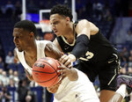 Vanderbilt forward Matthew Moyer (13) grabs Texas A&M guard Jay Jay Chandler in the second half of an NCAA college basketball game at the Southeastern Conference tournament, Wednesday, March 13, 2019, in Nashville, Tenn. Texas A&M won 69-52. (AP Photo/Mark Humphrey)