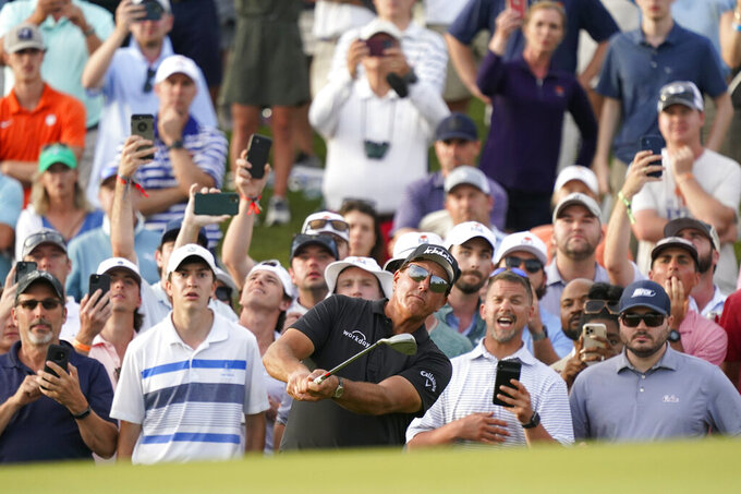 Phil Mickelson chips to the 18th green during the third round at the PGA Championship golf tournament on the Ocean Course, Saturday, May 22, 2021, in Kiawah Island, S.C. (AP Photo/Matt York)