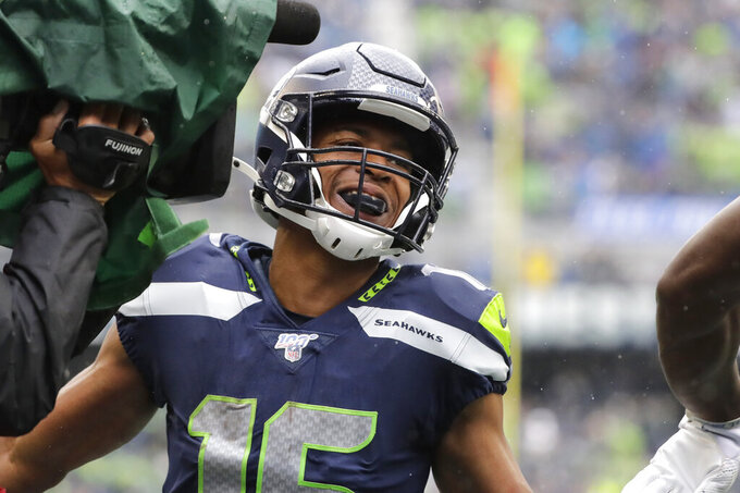 Seattle Seahawks' Tyler Lockett smiles after his touchdown reception against the New Orleans Saints during the first half of an NFL football game Sunday, Sept. 22, 2019, in Seattle. (AP Photo/Ted S. Warren)