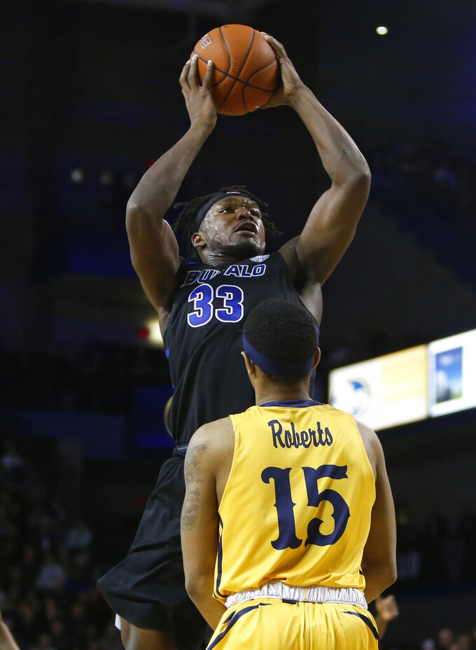 Buffalo forward Nick Perkins (33) shoots over Kent State guard Anthony Roberts (15) during the first half of an NCAA college basketball game, Friday, Feb. 22, 2019, in Buffalo, N.Y. (AP Photo/Jeffrey T. Barnes)