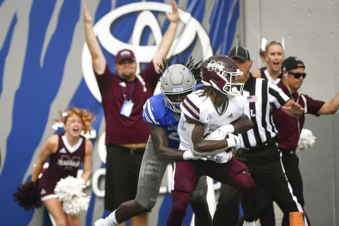 Mississippi State wide receiver Jaden Walley (11) catches a pass in the end zone to score as Memphis defensive back Tyrez Lindsey defends during the first half of an NCAA college football game on Saturday, Sept. 18, 2021, in Memphis, Tenn. (AP Photo/John Amis)