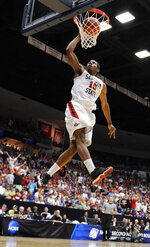 FILE- In this March 19, 2011, file photo, San Diego State forward Kawhi Leonard scores against Temple during a West Regional NCAA college basketball tournament game Tucson, Ariz. Nine years after Leonard helped lead San Diego State to national prominence, the Aztecs will honor the greatest player in program history by hoisting his No. 15 jersey into the rafters at Viejas Arena, high above Steve Fisher Court on Saturday, Feb. 1, 2020. (AP Photo/Chris Carlson, File)