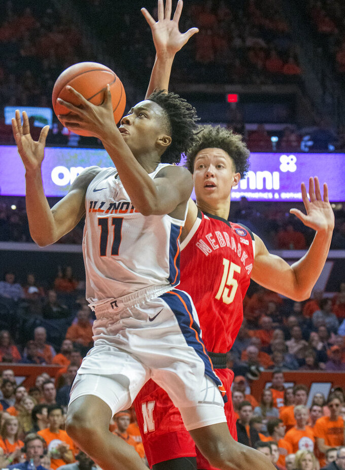 Illinois guard Ayo Dosunmu (11) is pressured by Nebraska forward Isaiah Roby (15) during the second half of an NCAA college basketball game in Champaign, Ill., Saturday, Feb. 2, 2019. (AP Photo/Robin Scholz)