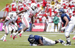 FILE - In this Sept. 1, 2018, file photo, Houston defensive tackle Ed Oliver (10) jumps over Rice offensive lineman Uzoma Osuji, center, to get around offensive lineman Jack Greene, right, during an NCAA college football game, in Houston. Oliver is a possible pick in the 2019 NFL Draft. (AP Photo/Michael Wyke, File)