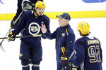 Nashville Predators head coach John Hynes, center, talks with right wing Viktor Arvidsson (33), of Sweden, and center Ryan Johansen (92) during NHL hockey training camp Tuesday, July 14, 2020, in Nashville, Tenn. (AP Photo/Mark Humphrey)
