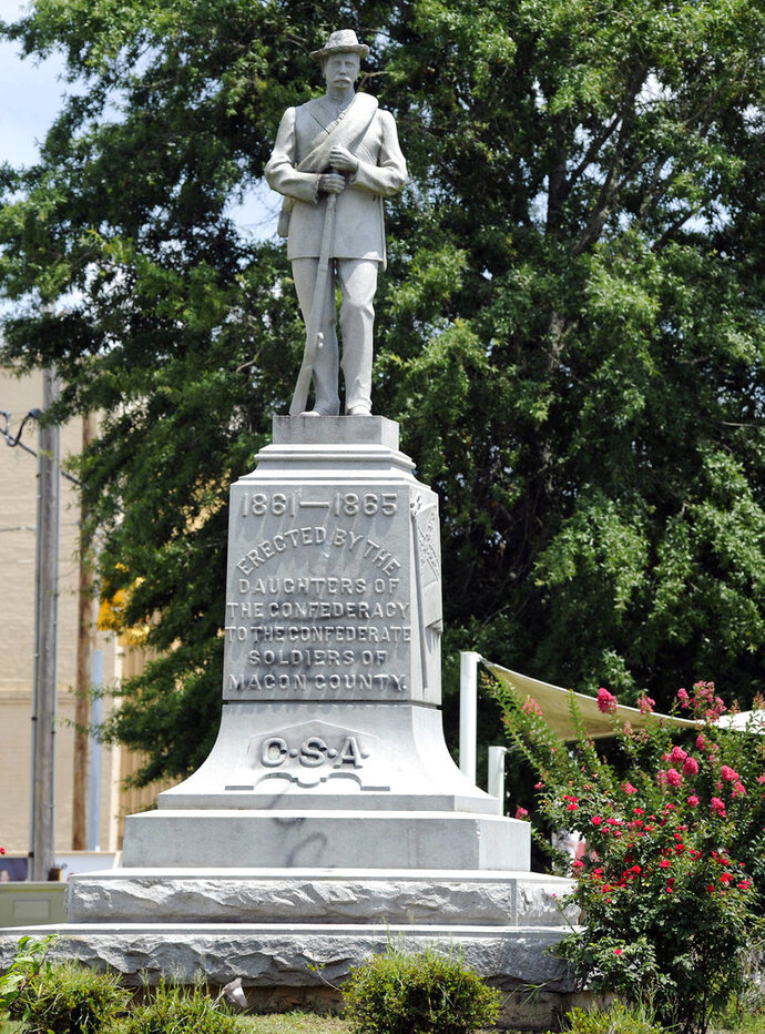 A Confederate monument dedicated in 1909 stands in the middle of the square in Tuskegee, Ala., on Thursday, June 28, 2018. Demonstrators once tried to topple the monument and it has been the target of vandals. Yet a Confederate heritage group owns the land, and the memorial has survived generations in a mostly black city known as a landmark of minority education and empowerment. Black graffiti from a vandalism incident that occurred last year is still visible on the base. (AP Photo/Jay Reeves)