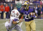 FILE - In this Sept. 16, 2017, file photo, Washington's Salvon Ahmed (26) rushes against Fresno State during the second half of an NCAA college football game in Seattle. Myles Gaskin is likely to rewrite the record book for No. 6 Washington by the end of his senior season. But he'll have help this season in the form of sophomore Salvon Ahmed. The duo get a major test out of the gates against No. 9 Auburn.  (AP Photo/Elaine Thompson, File)