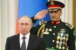Russian President Vladimir Putin, left, attends the official welcome ceremony during his meeting with Saudi Arabia's King Salman in Riyadh, Saudi Arabia, Monday, Oct. 14, 2019. (AP Photo/Alexander Zemlianichenko, Pool)