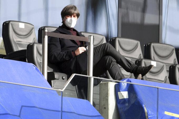 German national soccer team coach Joachim Loew sits in the stands prior to the German Bundesliga soccer match between Eintracht Frankfurt and Bayern Munich in Frankfurt, Germany, Saturday, Feb. 20, 2021. (Arne Dedert/POOL via AP)