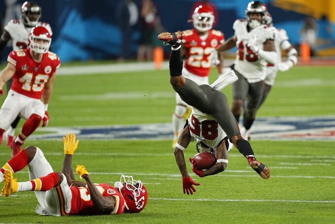 Kansas City Chiefs' Byron Pringle tackles Tampa Bay Buccaneers' Jaydon Mickens during the first half of the NFL Super Bowl 55 football game Sunday, Feb. 7, 2021, in Tampa, Fla. (AP Photo/David J. Phillip)