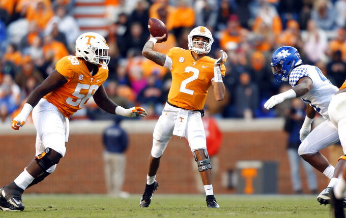 FILE -- In this Nov. 10, 2018, file photo, Tennessee quarterback Jarrett Guarantano (2) passes against Kentucky during an NCAA college football game in Knoxville, Tenn. Guarantano has thrown a school-record 146 consecutive passes without an interception. His growing confidence has helped Tennessee move one win away from bowl eligibility a year after a 4-8 season. Tennessee can become bowl eligible Saturday by beating Missouri in its home finale. (AP Photo/Wade Payne, File)