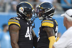 Pittsburgh Steelers Jayrone Elliott (40) is congratulated by defensive back Kameron Kelly following Elliott's interception and touchdown during the first half of an NFL preseason football game against the Carolina Panthers in Charlotte, N.C., Thursday, Aug. 29, 2019. (AP Photo/Mike McCarn)