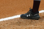 FILE - This April 5, 2019, file photo shows a detail view of the Under Armour logo on a cleat during an Grambling State University at Texas Southern University NCAA softball game in Houston. Under Armour Inc. has threatened Nike, landing major deals with Major League Baseball and star athletes like the NBA's Stephen Curry. But it also faces threats of its own, like the growing popularity of athleisure wear, clothing that can be worn at work and the yoga studio. (AP Photo/Aaron M. Sprecher, File)