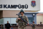 Members of Turkish forces guard the entrance to the prison complex in Aliaga, Izmir province, western Turkey, where jailed U.S. pastor Andrew Craig Brunson is held and is appearing on his trial at a court inside the complex, Monday, April 16, 2018. Brunson is going on trial for alleged terror ties and spying in a case that has increased tensions between Washington and Ankara. (AP Photo/Lefteris Pitarakis)
