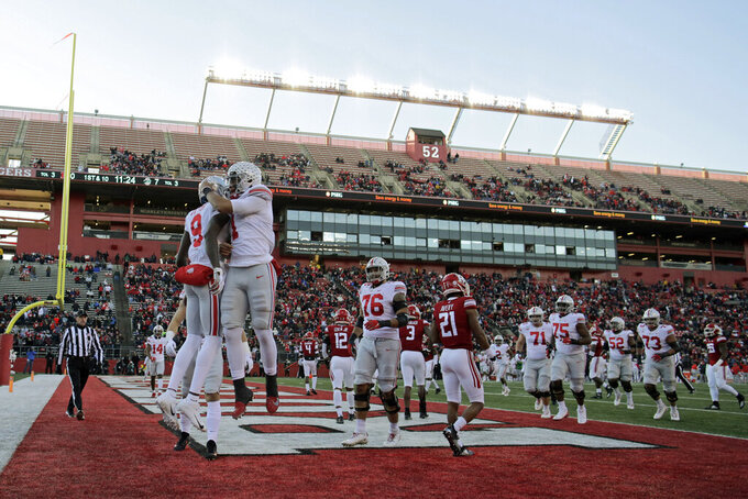 Ohio State quarterback Justin Fields (1) congratulates wide receiver Binjimen Victor (9) on scoring a touchdown during the first half of an NCAA college football game against Rutgers on Saturday, Nov. 16, 2019, in Piscataway, N.J. (AP Photo/Adam Hunger)