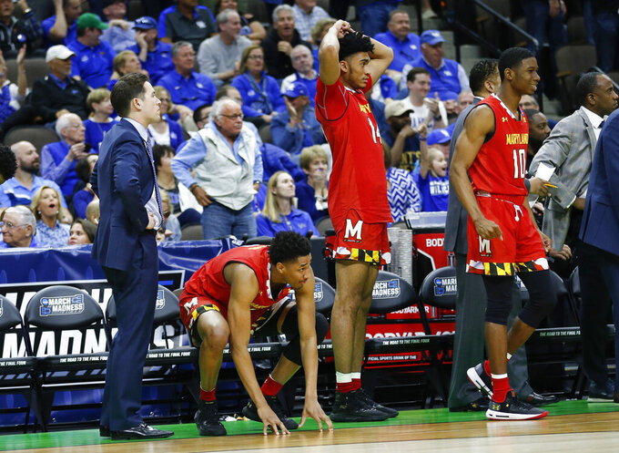 Maryland players, from left, Aaron Wiggins, Ricky Lindo Jr., and Darryl Morsell react as LSU makes a game-winning shot in the closing second of the second half of a second-round game in the NCAA men's college basketball tournament in Jacksonville, Fla., Saturday, March 23, 2019. (AP Photo/Stephen B. Morton)