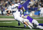 Monmouth tight end Shawn Clark (86) is taken down by James Madison linebacker Kelvin Azanama (54) and cornerback Rakeem Davis (41) during the first half of a second-round game in the NCAA Football Championship Subdivision playoffs Saturday, Dec. 7, 2019, in Harrisonburg, Va. (Daniel Lin/Daily News-Record via AP)