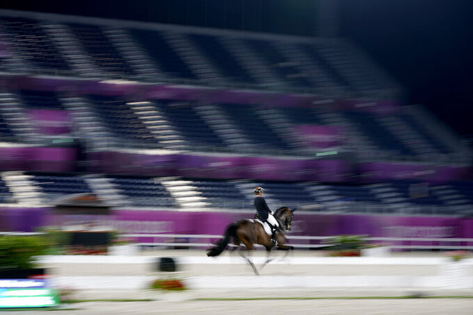 Germany's Dorothee Schneider, riding Showtime FRH, competes in the equestrian dressage individual final at the 2020 Summer Olympics, Wednesday, July 28, 2021, in Tokyo. (AP Photo/David Goldman)
