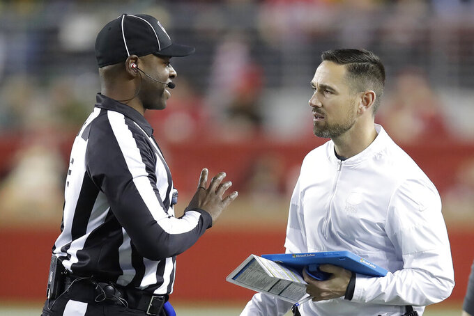 Green Bay Packers head coach Matt LaFleur, right, talks with field judge Eugene Hall during the first half of an NFL football game between the San Francisco 49ers and the Packers in Santa Clara, Calif., Sunday, Nov. 24, 2019. (AP Photo/Ben Margot)