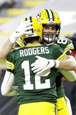Green Bay Packers' Robert Tonyan celebrates his touchdown catch with Aaron Rodgers (12) during the second half of an NFL football game against the Chicago Bears Sunday, Nov. 29, 2020, in Green Bay, Wis. (AP Photo/Mike Roemer)