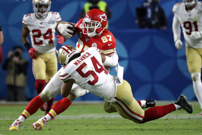 Kansas City Chiefs' Travis Kelce (87) is tackled by San Francisco 49ers' Fred Warner (54) during the second half of the NFL Super Bowl 54 football game Sunday, Feb. 2, 2020, in Miami Gardens, Fla. (AP Photo/Wilfredo Lee)