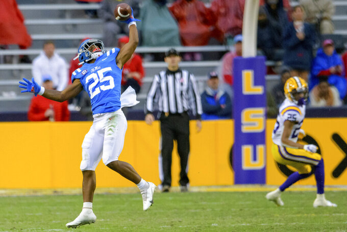 Mississippi running back Henry Parrish Jr. (25) makes a one-handed catch against LSU during the first half of an NCAA college football game in Baton Rouge, La., Saturday, Dec. 19, 2020. (AP Photo/Matthew Hinton)