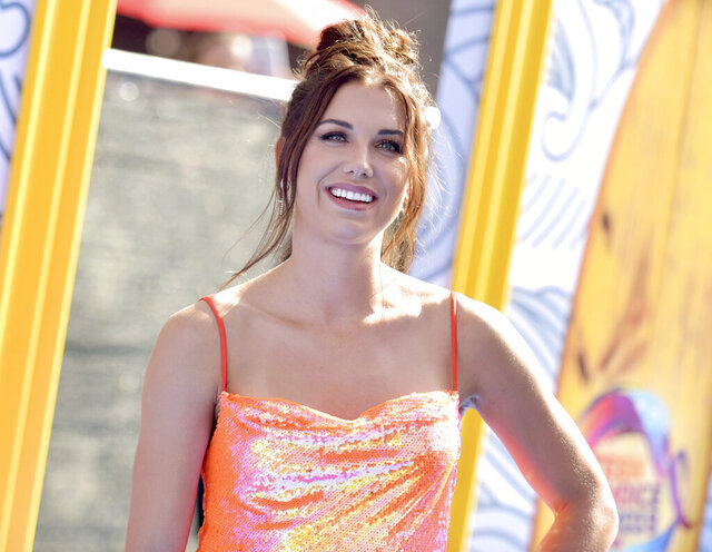 FILE - In this Aug.11, 2019 file photo, Alex Morgan arrives at the Teen Choice Awards in Hermosa Beach, Calif.  The U.S. national soccer team star has become a mom just in time for Mother's Day. Morgan announced Saturday, May 9, 2020, on social media that she gave birth to daughter Charlie Elena Carrasco on Thursday, May 7. (Photo by Richard Shotwell/Invision/AP, File)