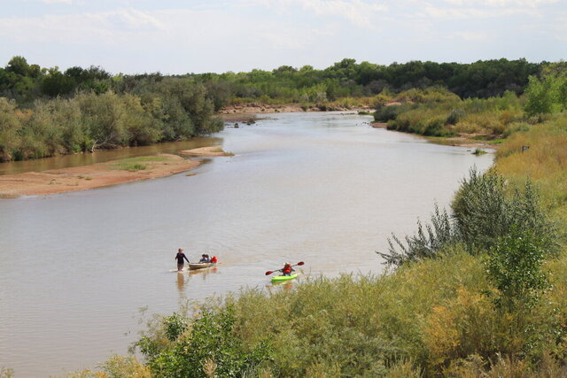 Boaters navigate the shallow Rio Grande as it flows through Rio Rancho, New Mexico, on Monday, Aug. 31, 2020. New Mexico and other southwestern states have been dealing with dry conditions and warmer temperatures this summer. (AP Photo/Susan Montoya Bryan)