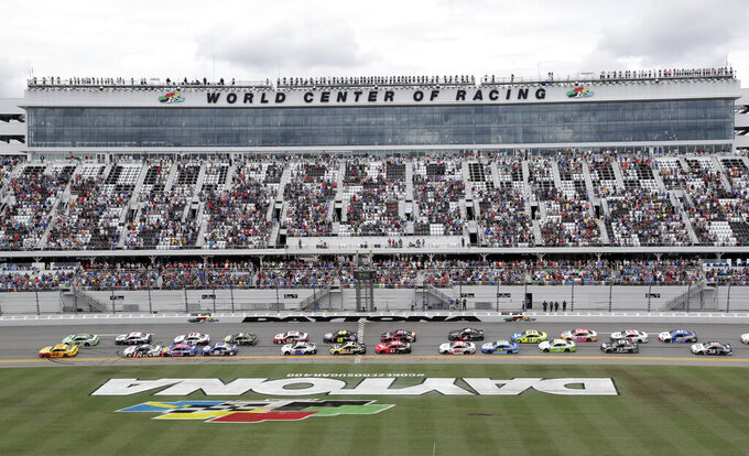Joey Logano (22) and Kyle Busch (18) lead the field to start the NASCAR Cup Series auto race at Daytona International Speedway, Sunday, July 7, 2019, in Daytona Beach, Fla. (AP Photo/John Raoux)