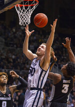 Butler forward Joey Brunk (50) pulls down a rebound during the first half of an NCAA college basketball game against Providence, Tuesday, Feb. 26, 2019, in Indianapolis. (AP Photo/Doug McSchooler)