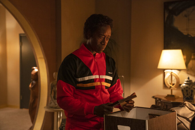 """In this image released by Showtime, Don Cheadle appears in a scene from the series """"Black Monday,"""" returning Sunday on Showtime. (Nicole Wilder/Showtime via AP)"""