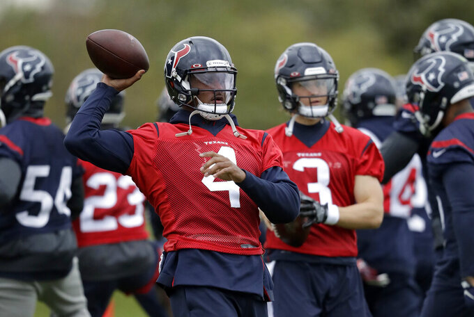 Houston Texans' quarterback Deshaun, 4, takes part in an NFL practice session at the London Irish rugby team training ground in the Sunbury-on-Thames suburb of south west London, Friday, Nov. 1, 2019. The Houston Texans are preparing for an NFL regular season game against the Jacksonville Jaguars in London on Sunday. (AP Photo/Matt Dunham)