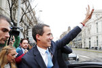 The leader of Venezuela's political opposition Juan Guaido waves during a visit to Madrid, Spain, Saturday, Jan. 25, 2020. Juan Guaido, the man who one year ago launched a bid to oust Venezuelan President Nicolas Maduro, arrived Saturday in Spain, where a thriving community of Venezuelans and a storm among Spanish political parties awaited him. (AP Photo/Paul White)