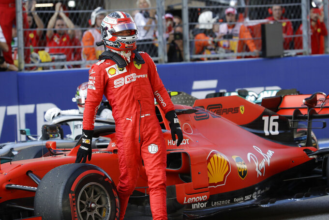 Ferrari driver Charles Leclerc of Monaco steers his racer celebrates after setting the pole position at the end of the qualifying session practice at the 'Sochi Autodrom' Formula One circuit, in Sochi, Russia, Saturday, Sept.28, 2019. The Formula one race will be held on Sunday. (AP Photo/Luca Bruno)
