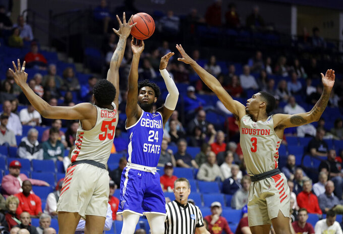 Georgia State's Devin Mitchell (24) shoots between Houston's Brison Gresham (55) and Armoni Brooks (3) during the first half of a first round men's college basketball game in the NCAA Tournament Friday, March 22, 2019, in Tulsa, Okla. (AP Photo/Jeff Roberson)