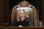 New Washington Supreme Court Chief Justice Debra Stephens speaks from the bench after she was sworn in, Monday, Jan. 6, 2020, in Olympia, Wash. Stephens replaced former Justice Mary Fairhurst as Chief Justice, who retired in January as she battles cancer. (AP Photo/Ted S. Warren)