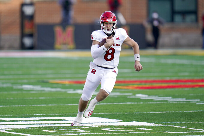 Rutgers quarterback Artur Sitkowski (8) runs with the ball against Maryland during the second half of an NCAA college football game, Saturday, Dec. 12, 2020, in College Park, Md. Rutgers won 27-24 in overtime. (AP Photo/Julio Cortez)