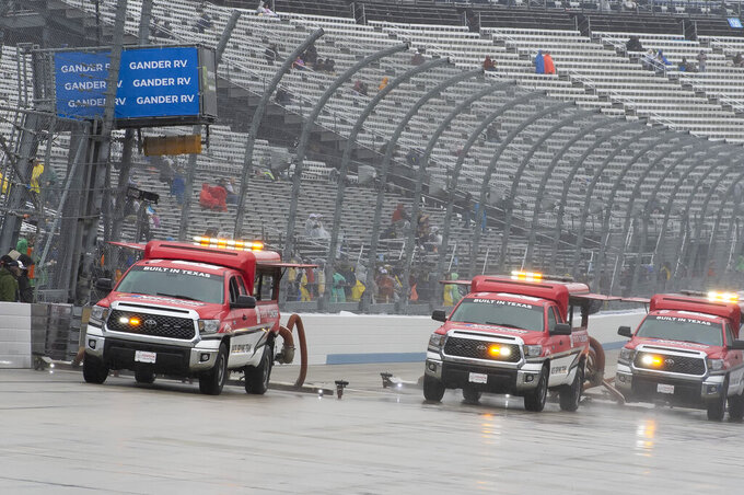 Track drying team works to dry the track before the start of a NASCAR Cup series auto race, Sunday, May 5, 2019, at Dover International Speedway in Dover, Del. (AP Photo/Jason Minto)
