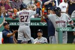 Houston Astros' Jose Altuve (27) celebrates his solo home run during the third inning of a baseball game against the Boston Red Sox, Wednesday, June 9, 2021, in Boston. (AP Photo/Michael Dwyer)