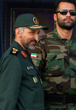 FILE-- In this Sunday, Nov. 26, 2006, file photo, Brig. Gen. Mohammad Hosseinzadeh Hejazi, left, attends a military parade in Tehran, Iran. Brig. Gen. Hejazi, deputy commander of the Quds, or Jerusalem, force of Iran's paramilitary Revolutionary Guard, has died, the Guard Corps announced on Sunday, April 18, 2021. The unit is an elite and influential group that oversees foreign operations, and Hejazi helped lead its expeditionary forces and frequently shuttled between Iraq, Lebanon and Syria. (AP Photo/Vahid Salemi, File)