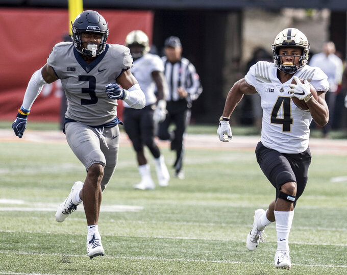 Purdue running back Rondale Moore (4) heads to the end zone pursued by Illinois' Del'Shawn Phillips (3) in the first half of a college NCAA football game between Illinois and Purdue, Saturday, Oct. 13, 2018, in Champaign, Ill. (AP Photo/Holly Hart)