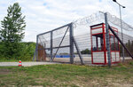 FILE - In this Tuesday, May 7, 2019 file photo the transit zone for asylum seekers is pictured in Roszke, Hungary. Hungary's government says it is shutting down the transit zones on its southern border with Serbia where asylum-seekers are being kept while their asylum requests are decided. (AP Photo/Pablo Gorondi, file)